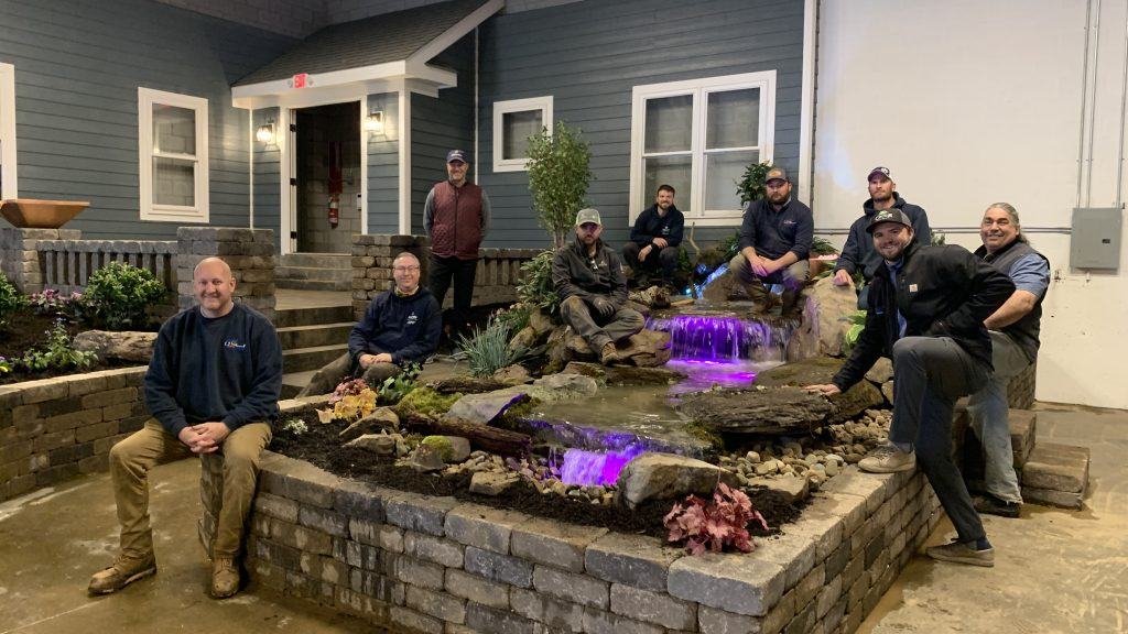 Art of the Yard, Alpine Custom Hardscapes, August Moon Designs and Atlantic-OASE staff in front of a pond-free waterfall