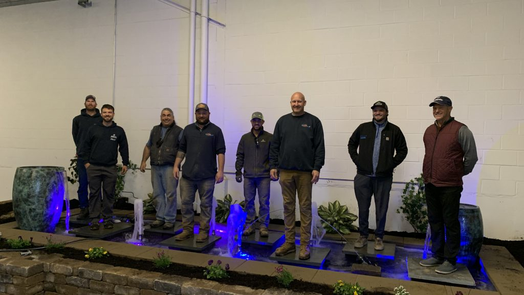 Art of the Yard, Alpine Custom Hardscapes, August Moon Designs and Atlantic-OASE staff standing in a formal fountain hardscape