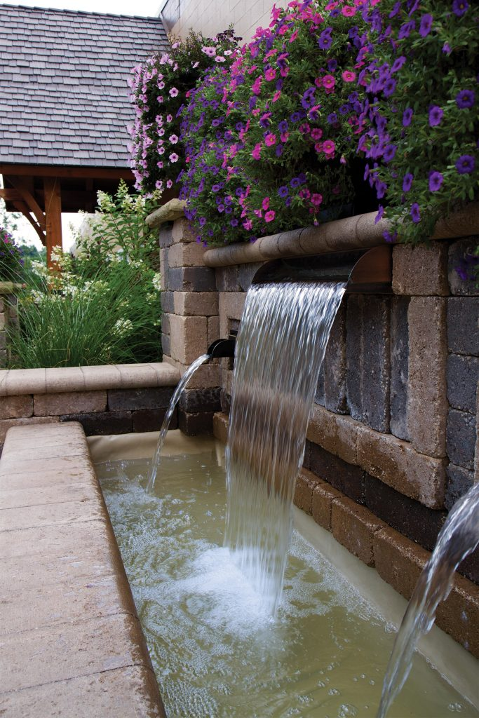 Hardscape Formal Spillway basin with a Stainless Steel Spillway and two Wall Spouts flowing into the basin
