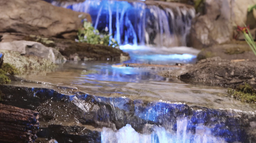 Pond-free waterfall close up with blue color changing lighting