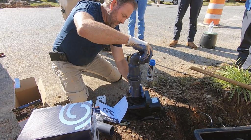 Contractor installing a Triton Check Valve into a TT6000 pump