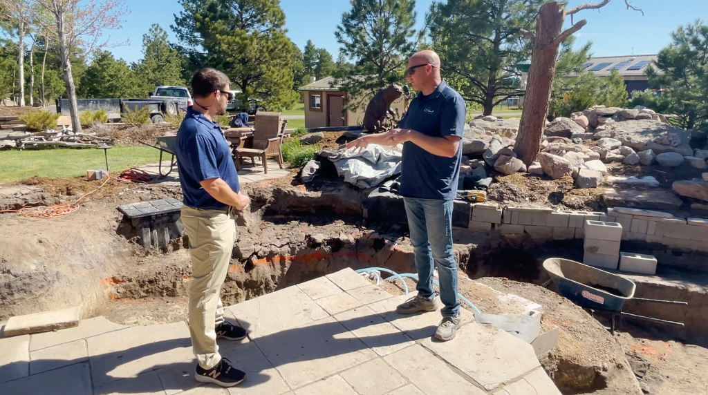Pond contractor showing how to construct a koi pond
